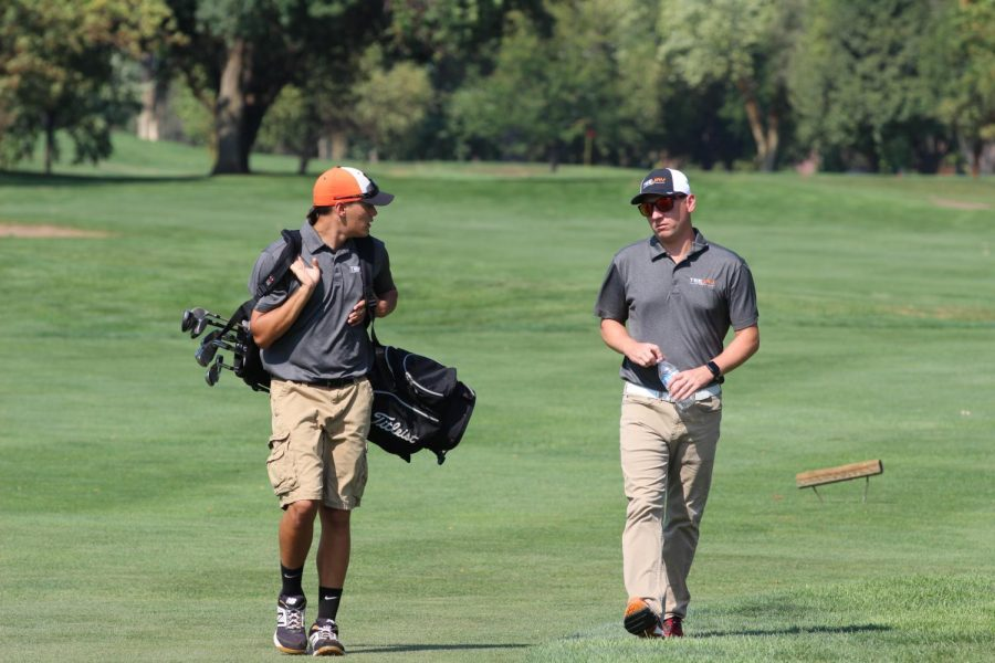 CBTJ senior Grant Merk and boys golf coach Rob Lindquist, at the City Meet on October 4, 2019.