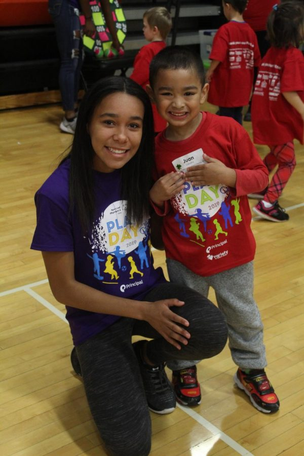 Suzie Miller posing for a picture with one of her group members during the Special Olympics.