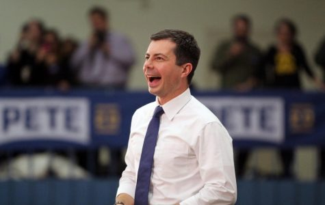 Democratic nominee candidate Mayor Pete Buttigieg reacts to the crowd at his town hall in Council Bluffs, Iowa on November 25, 2019.