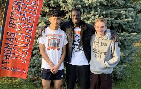 Left to right: Juan Martinez, Wimach Gilo, Adian Booton pose at the State Meet held in Fort Dodge.