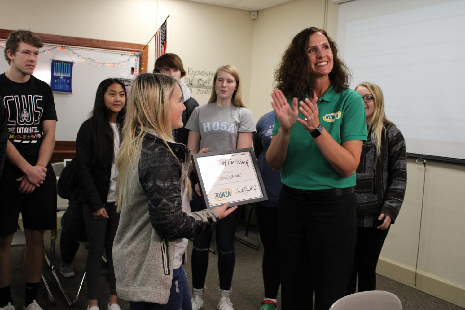 Natalie Arnold receiving her Student of the week award from Runza.