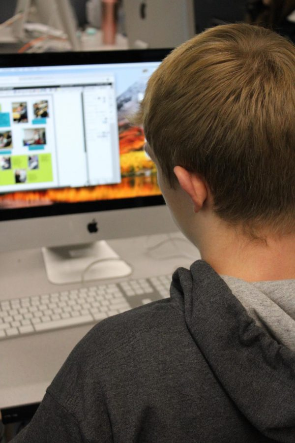 CBTJ sophomore Konnor Stanfill working hard on the pages for yearbook.