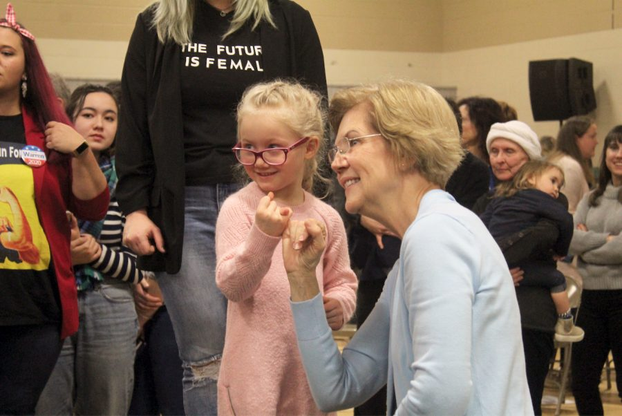 Democratic+Presidential+hopeful+Senator+Elizabeth+Warren+makes+a+promise+with+a+young++girl+after+speaking+at+Wilson+Middle+School++on+December+29%2C+2019.+
