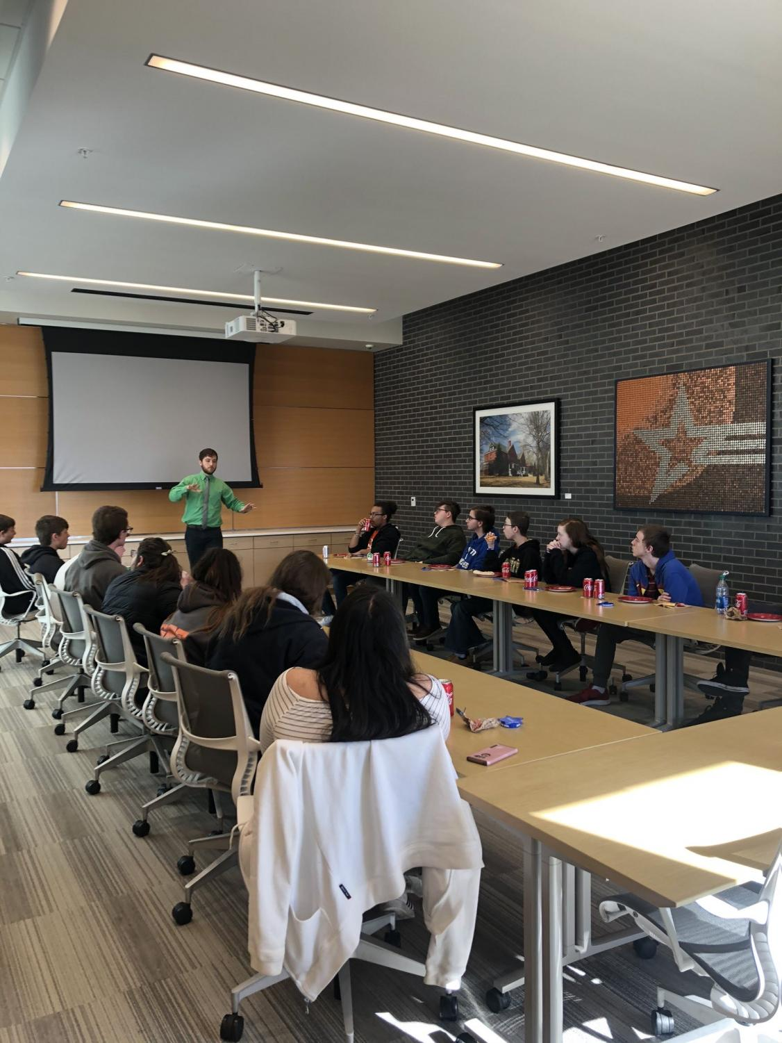 TJ Computer Science students learning about I.T., eating pizza at Cobalt Credit Union for Careerockit week.