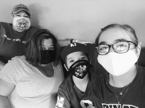 (Left to right) Patrice, Heather, Levi, and I wearing our masks at home.