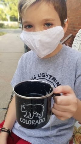 My little brother, Levi, and I grilling outside and enjoying some tea while in quarantine.