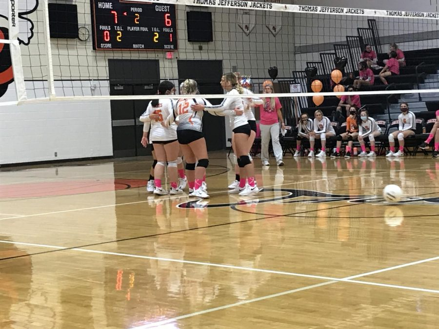 TJ Volleyball Girls gather and give each other a pat on the back.