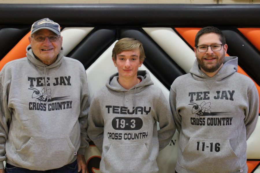 Senior Aiden Booten will be the first Thomas Jefferson  Cross Country runner to run at three state meets. He is pictured with Cross Country coaches, Doug Muehlig (left) and Kyle Bartholomew.