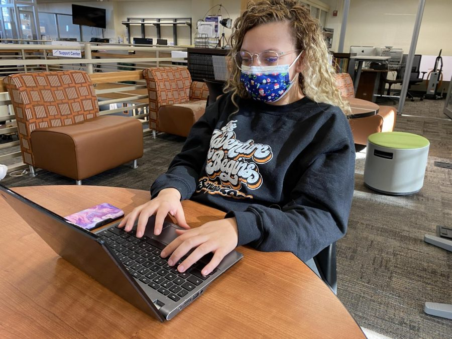 TJHS senior Cyann Rankin wears a pair of blue light blocking glasses while working on her Chromebook.