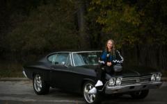 Senior Chevelle Loparco posing next to her 1968 Chevelle.