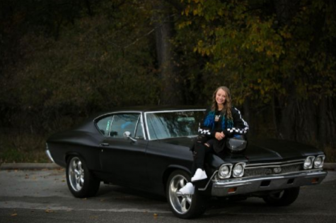 Senior Chevelle Loparco posing next to her 1968 Chevelle.