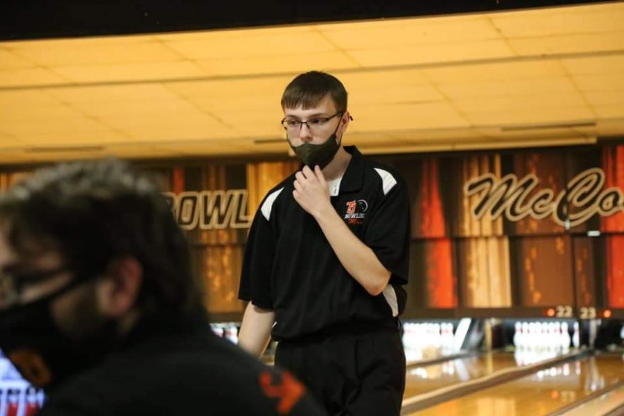 Senior Max Schuster reacts after throwing his ball during a bowling meet.