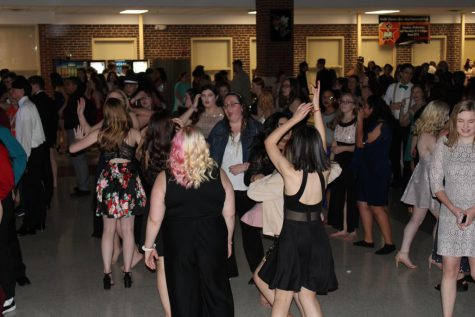 Students dance in this file photo from Snoball in the TJ commons in 2020, the last dance that was held before the pandemic.
