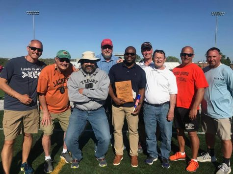 2005 TJ graduate James Smith poses (center) with his former coaches during his induction to the CB Relays Hall of Fame on April 29, 2021. Pictured (L-R) are Pat Nepple, Doug Muehlig, Jay Conyers, Cyle Forney, Smith, John Kinsel Bob Nielsen, Dan Strutzenberg, and David Lutz.