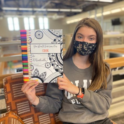 Yearbook distribution will be Monday, May 17 from 1p-4p in the TJHS parking lot (under the red canopy). Here, one of the Yearbook advisers Chrisha Doss, holds the 2020-2021 book.