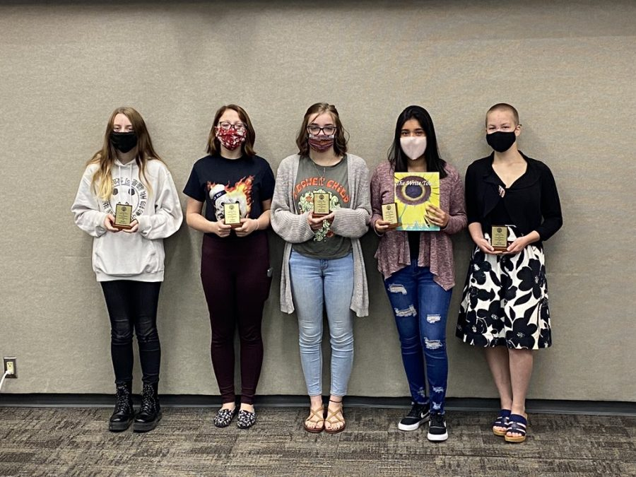 Five TJ students were published in this year's Write Touch - A Literary Magazine by Youth Authors and Artists of Council Bluffs! Kylie, Chloe, Paxton, Nairi, and Ross were celebrated with a plaque and award from the CB Optimist Club on May 7, 2021.